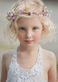 Beautiful portrait pose for a little girl. She looks angelic…