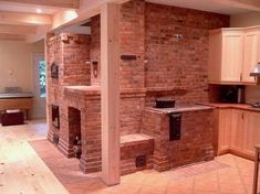 This, my friends, is a masonry heating system. It burns hotter and more complete than your average fireplace, takes less wood, and gives off ambient heat from the brick or stone. I'm getting one someday.