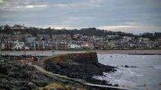 A comprehensive guide to southeast Scotland tourist attractions along its beautiful coast. Explore famous castles, sandy beaches, old towns and long trails. Scotland Tourist Attractions, Scotland Beach, Famous Castles, Sandy Beaches, East Coast, Old Town, Paris Skyline, Explore, Travel