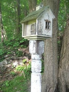 Old post and birdhouse. (House even has a screen door!)