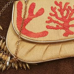 Rare Felix Rey  Straw clutch NWOT This straw clutch w coral embroidery is certain to make a statement, there is the remnant of the tag on the interior but the actual tag has been removed...small stain/marking on interior, in otherwise blemish free condition. There is a clip on the inside to clip a strap. It the strap is missing. Price reflects item as described. Felix rey Bags Clutches & Wristlets
