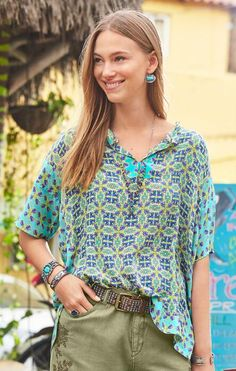 The Marella Top's lightweight silk fabric and beautiful print makes it a versatile piece for styling.
