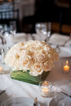 An elegant modern arrangement of ivory roses by B Floral
