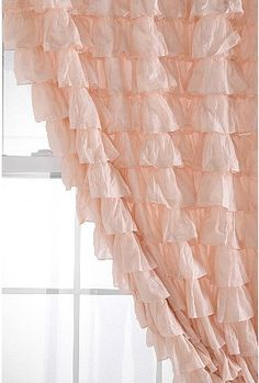 Love the pale pink ruffled curtain!