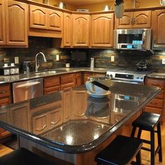 Granite Countertops and slate Tile Backsplash