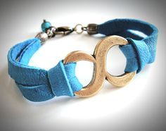 Big Brass Infinity bracelet on soft blue leather. $24 from JewelryByMaeBee on Etsy.