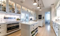19 Celebrity Kitchens That Will Make You Jealous: Celine Dion's mega mansion, which is now on the market for $62.5 million, boasts a main house, guest house, tennis house, pool house, and a waterpark. The kitchen isn't so bad either — the all-white space looks perfect for prepping a big dinner party.