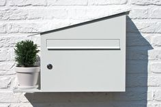 """Mailbox by Marcial Ahsayane - Dubbed """"Green"""" as it has a plant shelf and is self irrigating."""