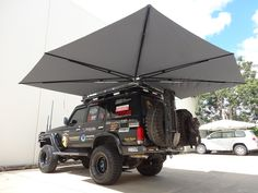 For all your camping, fishing, boating and vehicle awning needs, the Clevershade has you covered. Truck Tent, Truck Camping, Overland Truck, Expedition Vehicle, Jeep Wrangler Accessories, Jeep Accessories, Vw T3 Syncro, Nissan Xterra, Off Road Camper