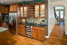 Medium wood cabinets, for multi purpose in kitchen with entertaining.