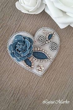 A heart-shaped brooch with a denim flower on a white background, is hand sewn from a zipper, felt, denim flower and clear strass on a silver metal base. Components in silver color. The back side is felt. Size: approx. 7.0 x 6.5 cm The earrings are made and shipped 5 days from