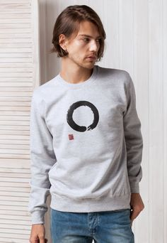 ENSOU CIRCLE JAPANESE CALLIGRAPHY MENS ・WOMENS ・UNISEX SWEATSHIRT Zen circle drawn in one strong brushstroke. A concept as simple as it is deep. An open enso calligraphy with the hanko stamp.  「円相」書道家が書くのデザインのトレーナー。  Male model wears a size Medium and is 186cm/61 tall, chest size 96cm/37.8. Female model wears a size X-Small and is 162cm/53 tall, chest size 84cm/33.4.  Screen printed in England on Superior Pre-Shrunk cotton Sweatshirt.   Sweatshirt sizes:  - Size XS : Acros...