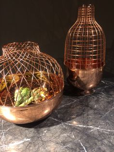 Copper vessels sitting on Draenert marble table