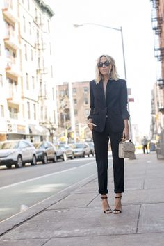 You're sure to generate a sleek and sophisticated all black style by wearing a flashy black two piece suit with simple stiletto sandals. We love this androgynous style. Via Jacey Duprie. Trousers/Blazer: Rag & Bone, Sandals: Chaos.