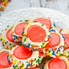 Iced Thumbprint cookies - Tender, buttery sugar cookies rolled in colorful sprinkles and filled with icing!