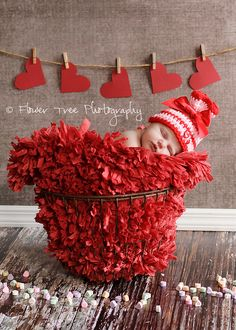 love the paper hearts on a clothesline backdrop -- that's my favorite part even though the baby is stinking cute!!
