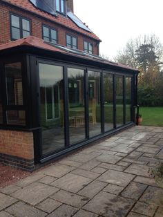 origin bi-fold doors on a beautiful conservatory with one of our guardian roofs. http://www.beeclear-windows.co.uk/  home improvement, dream house, renovation,