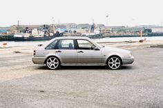 """1994 Volvo 440 2.0i SE. Lowered 40mm, colour coded door and bumper strips, custom clear blinkers, 1996 spec rear lights and number plate panel. 17"""" TSW EVO-R alloys and a custom made stainless-steel exhaust with 4"""" rolled tip. Big stereo in the boot too!"""