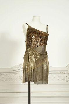 3858ba14e2a0 Gianni VERSACE couture Circa 1994 1995 Mini robe de cocktail à bretelles,  buste en velours dévoré lamé imprimé de taches panthères, jupe et dos en  cotte de ...