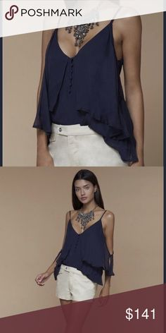 The Jet Set Diaries Babbette Top Adjustable Spaghetti Strap Navy Blouse with Button Detailing on Center Front.   Main - 100% Polyester Lining - 100% Rayon Zimmermann Tops Blouses
