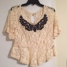 Free People lace top S Excellent condition. Free people lace top with a darkish gray/blue detailing on the front. So cute. Size Small. Let me know if I can help you in any way! I also offer 20% off on two or more items:) thanks for looking Free People Tops
