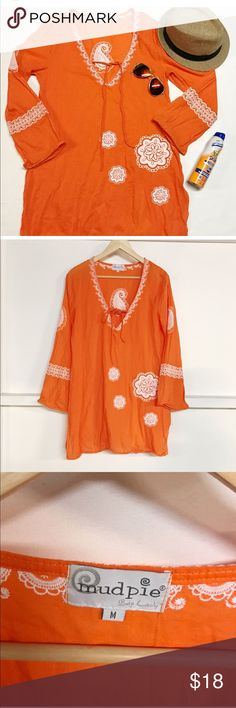 Medium boho Orange embroidered tunic. Medium boho Orange embroidered tunic.  Brand: Mud Pie  excellent condition, Material cotton  length 31 inch pit to pit 18 inch Mud Pie Tops Tunics