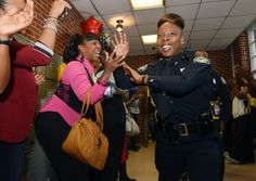 OCTOBER 17, 2013 ATLANTA Officer Nakisa Jones celebrates with family and friends, including Michelle Roberson (left). The Atlanta Police Dep...