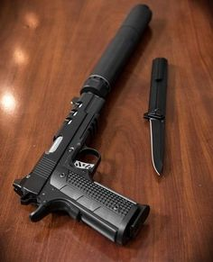 Dan Wesson firearms Discretion 1911 with Dead air silencers Ghost suppressor. With Qwaiken blade.