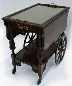 Mahogany Tea Cart, showing wonderfully how the design aesthetic extends beyond the packaging for the tea itself, and the merchants that house them. Serving Trolley, Tea Trolley, Drinks Trolley, Antique Tea Cart, Antique Tables, Tea Cup Display, Brass Bar Cart, Furniture Styles, Furniture Ideas
