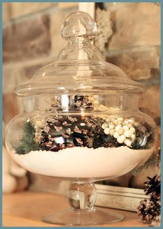 Apothecary jar filled with natural elements and epsom salt for snow - pretty winter decor
