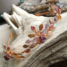 In this collection, I have combined amethyst rounds with glorious coppery leaves and wire to bring a bit of the autumnal prairie magic to you:)  $125 on Etsy