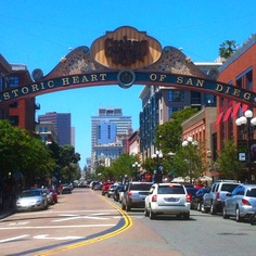 The Gaslamp Quarter is the historic heart of San Diego, California. It is a 16½ block historical neighborhood in Downtown San Diego and is the center of downtown night life. The Quarter is home to many events and festivals, including Mardi Gras in the Gaslamp, Street Scene Music Festival, Taste of Gaslamp and ShamROCK, a St. Patrick's Day event. PETCO Park, home of the San Diego Padres is located one block away in downtown San Diego's East Village. The area is listed as a historic district on the National Register of Historic Places as Gaslamp Quarter Historic District. Its main period of development began in 1867, when Alonzo Horton bought the land in hopes of creating a new city center closer to the bay, and chose 5th Avenue as its main street. After a period of urban decay, the neighborhood underwent urban renewal in the 1980s and 1990s, and is today an energetic business and entertainment district. The Gaslamp Quarter extends from Broadway to Harbor Drive, and from 4th to 6th Avenue, covering 16½ blocks. It includes 94 historic buildings, most of which were constructed in the Victorian Era, and are still in use with active tenants including restaurants, shops and nightclubs.