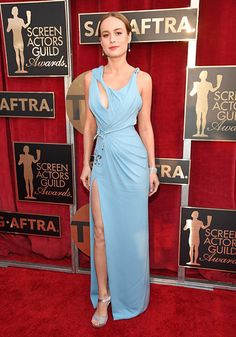 BEST: Brie Larson  Coming off a winning Golden Globes look — who could forget that gorgeous gilded gold gown? — the pressure was on for breakout actress Brie Larson to pull off another stylish awards show moment. In cool blue Atelier Versace, complete with a thigh-high slit, cleavage cutout and sexy draping, she definitely succeeded. #SAGAwards