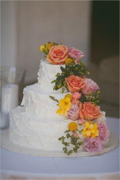 flower cascade wedding cake #weddingcake #whiteweddingcake #weddingchicks http://www.weddingchicks.com/2014/03/12/santa-barbara-yellow-and-gray-wedding/
