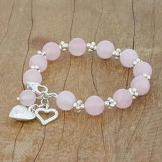 Rose Quartz Beaded Bracelet with Heart Charms from Thailand - Soft Hearts Beaded Bracelet Boho Beaded Bracelet Color Combos Beaded Bracelet Stretch Rose Quartz Bracelet, Gemstone Bracelets, Gemstone Jewelry, Rose Quartz Heart, Diamond Bracelets, Handmade Beaded Jewelry, Handmade Bracelets, Diy Beaded Bracelets, Clasps For Bracelets