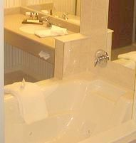 """How to clean a jetted tub  Run the tub full (3"""" above the highest jet) of HOT water  Add  1/4 Cup of dishwasher detergent  1/2 Cup of bleach  Run jets for 25 minutes  Drain  Fill with cold water and run jets for 10 minutes to rinse"""
