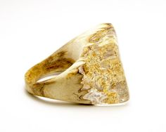 This unique cocktail ring was made with a beautiful piece of black locust wood. The resin is clear so you can see all the sparkly gold flakes inside. Its a great ring for anyone that wants to add little bit of sparkle to their day. The ring is about a size 7. Each piece of resin and wood jewelry is created completely by hand. It is a process of cutting wood, casting resin, re-cutting, shaping sanding and polishing it to a smooth shiny finish. I've used many different resins, but have found…