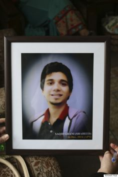 Amineh Hoti holds a photograph of one of the boys who was killed in the Peshawar school attack.