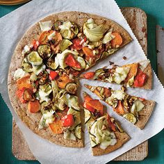 Roasted Vegetable Pizza | If you're craving a loaded-out pizza, give this veggie pizza a try! A whole wheat crust topped with roasted sweet potatoes and other colorful veggies ups the good-for-you-factor without skimping on flavor.