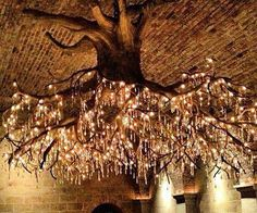 Give the formal dining room of your not so modest abode a regal feel that'll turn heads with this stunning tree chandelier. This spectacular piece features dozens of sprawling branches that spread in all directions to light up every inch of the room.