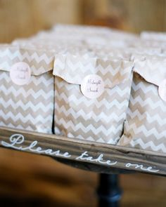 Wedding Favors Packaged In Glassine Envelopes Stitched With Red Thread Details
