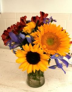 Sunflower surprise!! These giant sunflowers pop with surrounding light grape and merlot blooms!