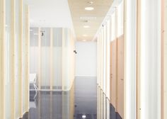 Frosted glass walls partition Sendagrup Medical Centre by Pauzarq