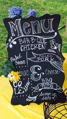 Chalkboard sign at an I Do BBQ reception party: BBQ chicken, pulled pork, hot dogs, Mac n cheese, corn, salad