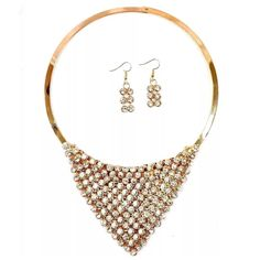 """D40 Gold Austrian Crystal Draping Necklace ‼️PRICE FIRM‼️   Austrian Crystal Necklace  Retail $89   BEYOND STUNNING!!!  Austrian crystals adorn this flexible draping triangle shape. A true fashion statement. Necklace is approximately 16.5"""" around. Crystal section is approximately 4.5"""" by 2.5"""".  Comes with free matching stud earrings. Sure to dress up even the most basic outfit!  Please check my closet for many more items including designer clothing, shoes, handbags, scarves and much more…"""