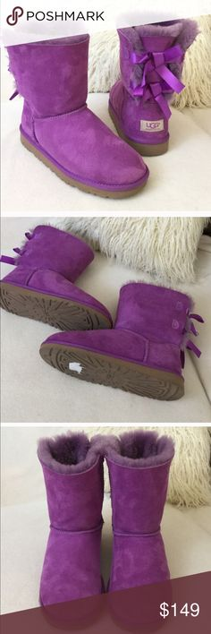 "UGG Violet suede 🎀bow boots UGG Violet suede 🎀bow boots   Stunning color suede with double bow back. These have been gently loved and in overall wonderful condition.  Stay cozy and stylish. States size 6 but will fit size 8 perfectly.  As always authentic measures 9"" tall UGG Shoes Winter & Rain Boots"