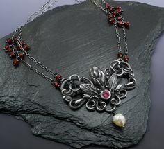 Vineyard Lace  Contemporary Jewelry Design by Holly Gage Sculpted Fine silver, rubies, garnets, and baroque pearl.