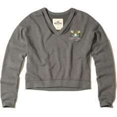 Hollister Cutout V-Neck Crop Sweatshirt ($40) ❤ liked on Polyvore featuring tops, hoodies, sweatshirts, heather grey, cropped sweatshirt, v neck sweatshirt, v-neck tops, embroidered sweatshirts and cropped tops