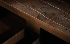 Very precise detailing of the conncetion between kitchen top in marble and side in wood. The Minotti Velia kitchen by Silvano Benetti and Alberto Minotti.