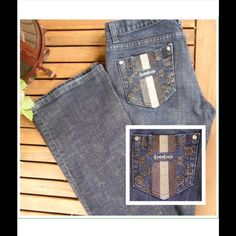 """bebe Premium Denim Bootcut Jeans Host Pick EUC They look brand new! No fading or fraying. Rhinestone embellished pockets with no missing rhinestones. Faded dark wash look and light weight. Rise 8""""; Inseam 34; Leg width 9 1/2"""" boot cut bebe Pants"""